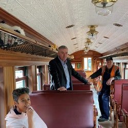 Paula and Scott admiring one of our award-winning carriage restorations, with driver Dave in the background..