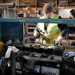 Anton Douglas hard at work installing Loco 1's new Isuzu diesel engine.